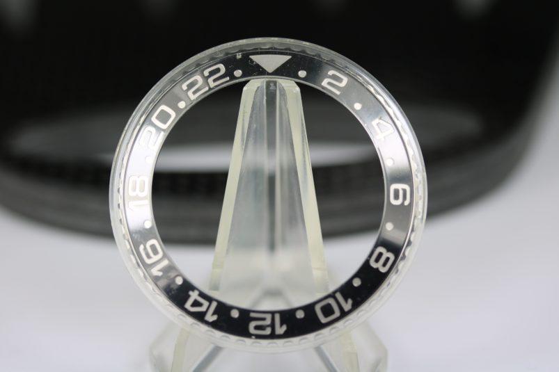 Rolex 116710 bezel