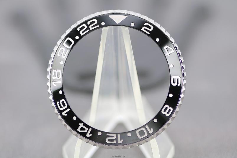 Rolex 116710 LN bezel